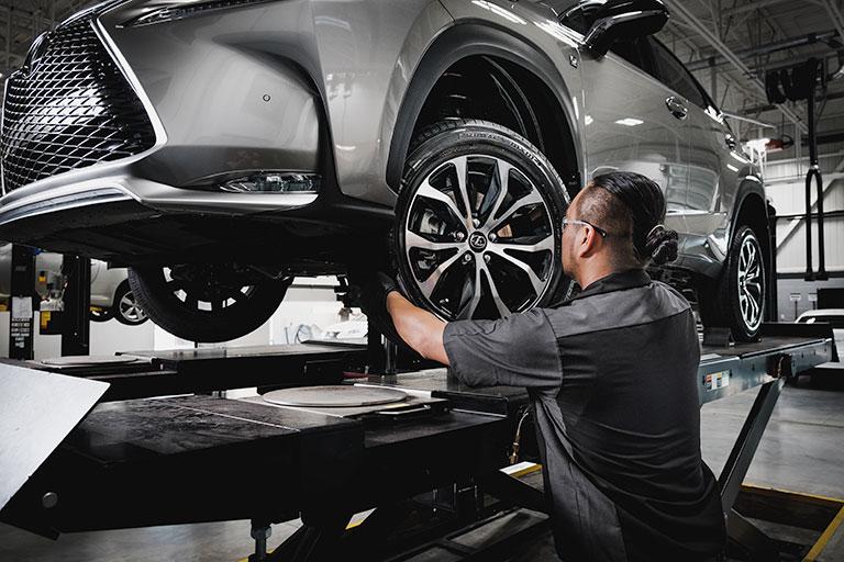 Lexus mechanic conducting s tire rotation