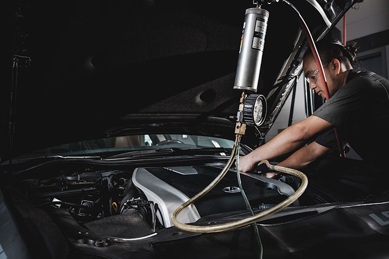 A Lexus certified technician cleaning the fuel system
