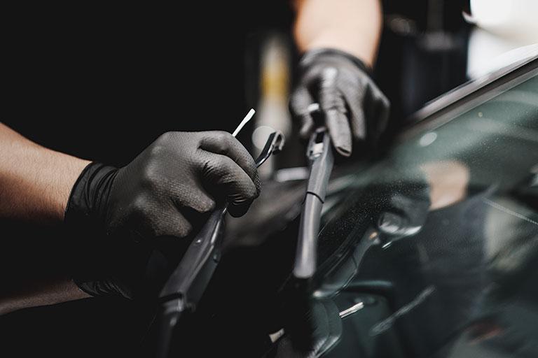 Lexus mechanic servicing wiper blades