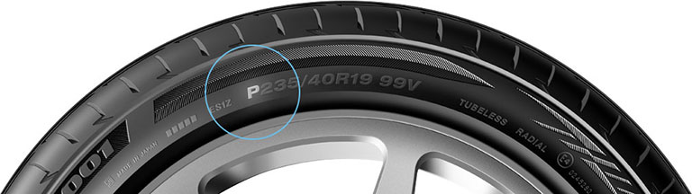 Close-up of passenger car tire P-metric size P is emphasized